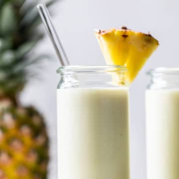 smoothie in a glass with a pineapple wedge