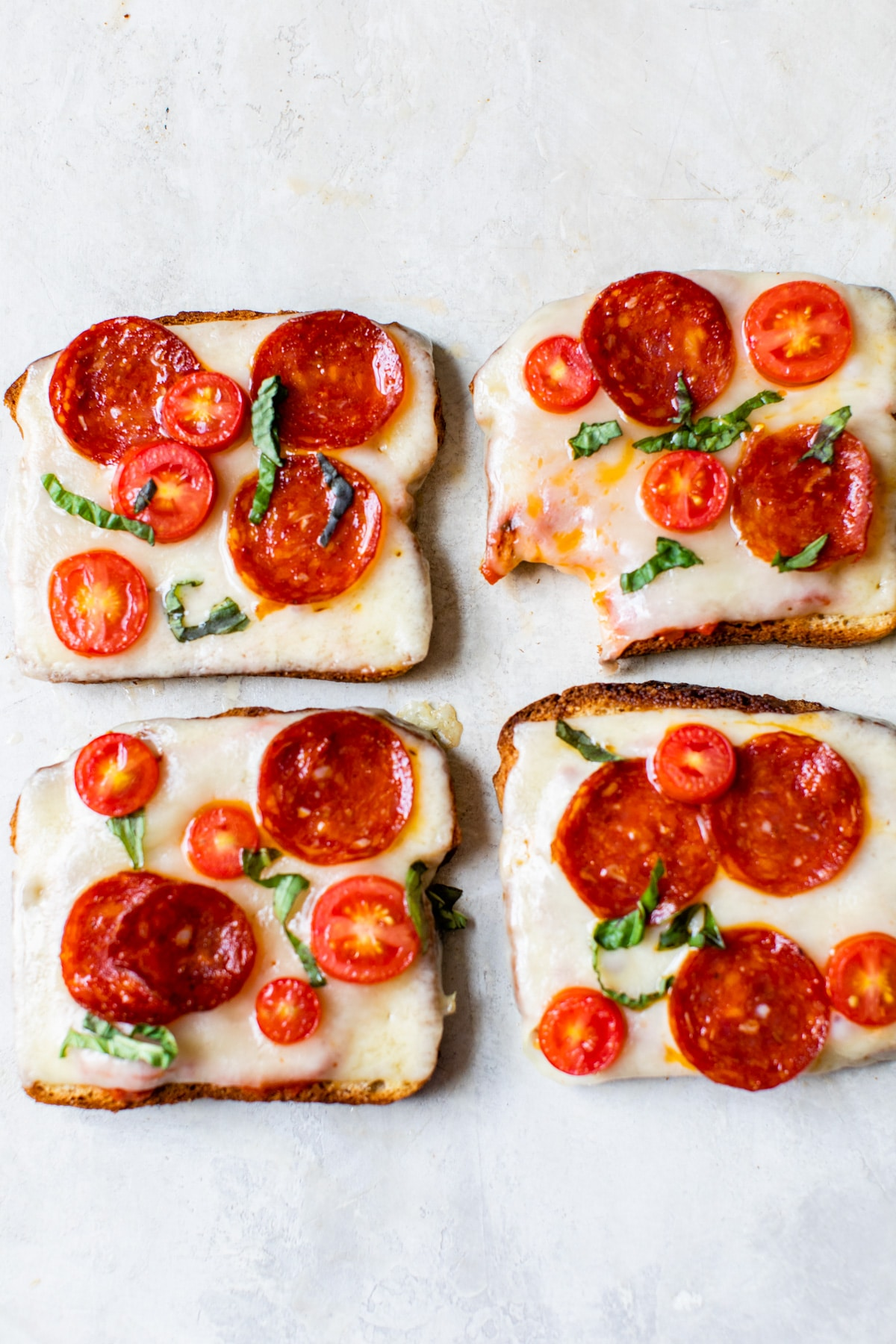 toast topped with cheese and pepperoni