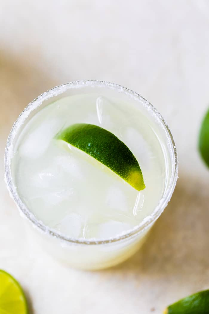 lime infused drink in a glass with ice