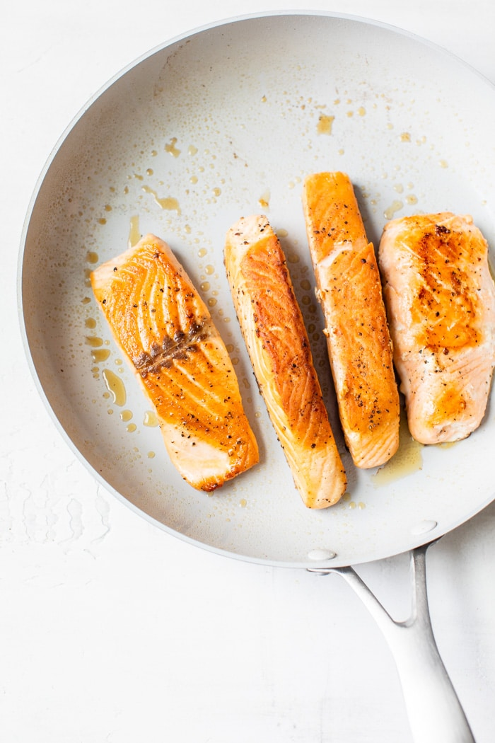 pan-seared salmon in a skillet