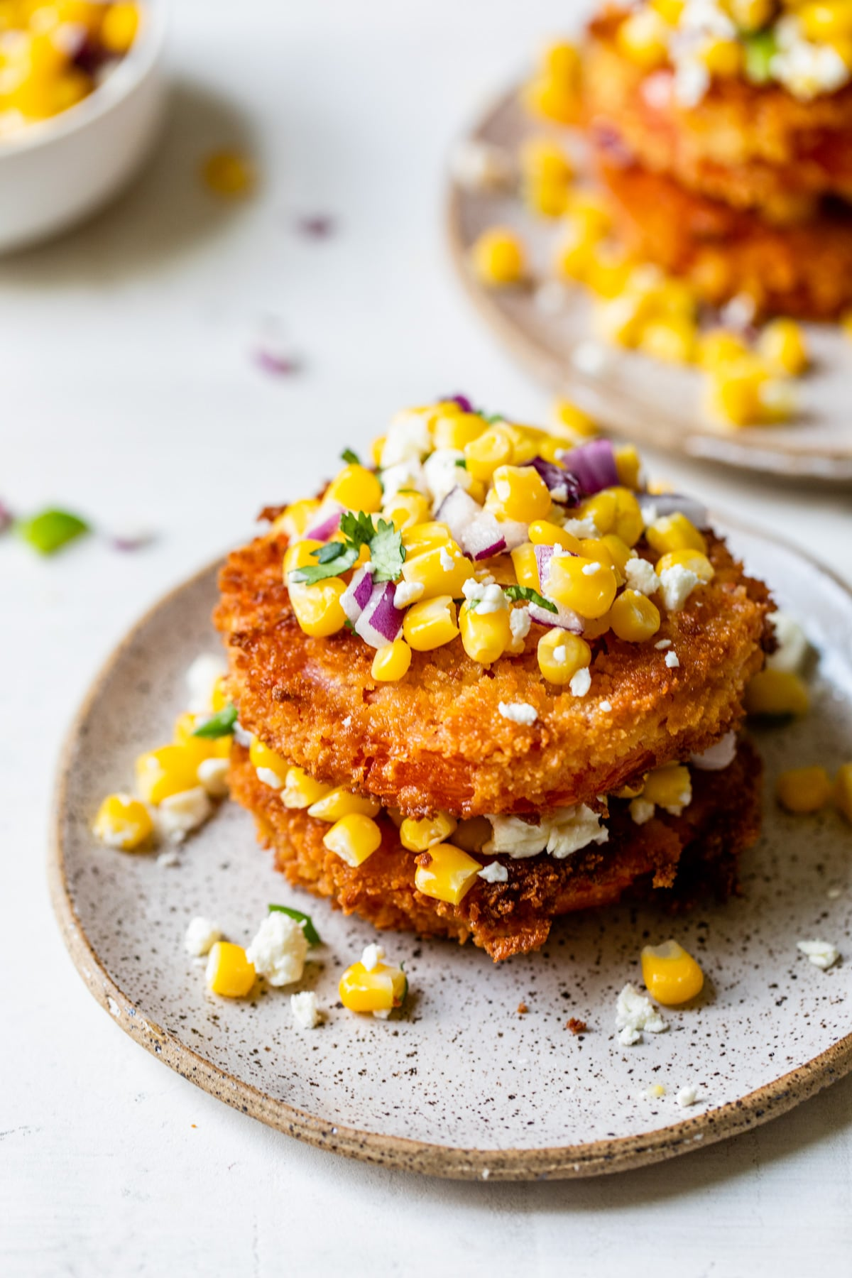 stack of fried tomatoes with corn on top