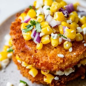 fried tomato slices topped with corn