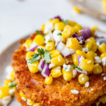 fried tomato slices topped with corn with text overlay