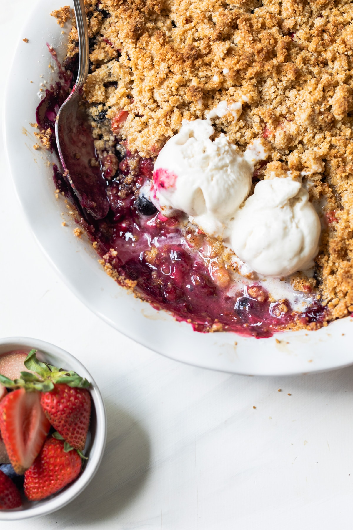 berries and ice cream in a pie pan