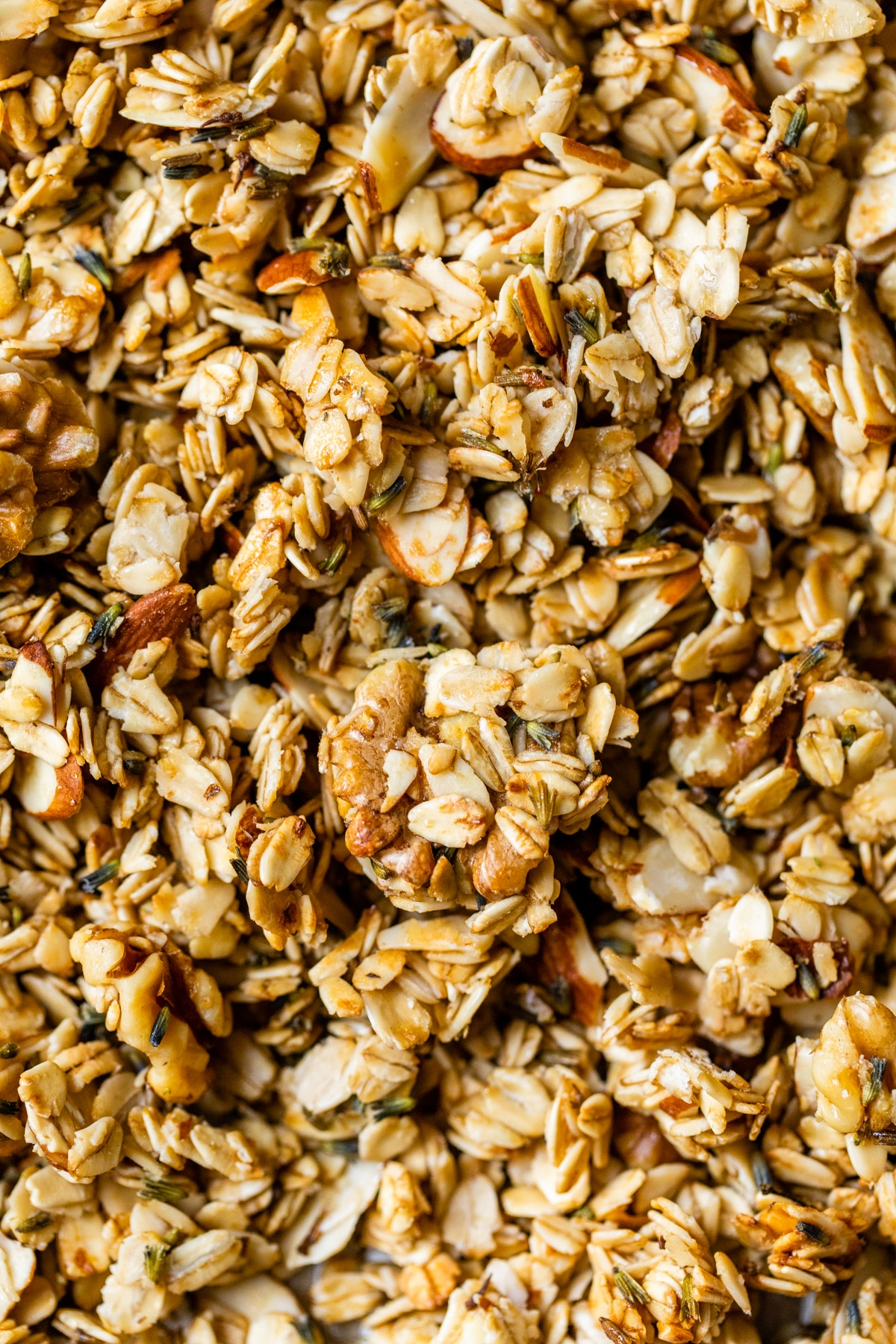 close up of granola on a baking sheet