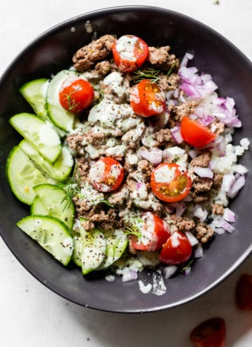 bowl with cucumber, tomatoes, onion, and ground lamb