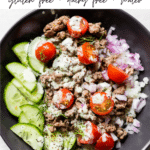 bowl with lamb, cucumber, tomatoes and red onion with text overlay