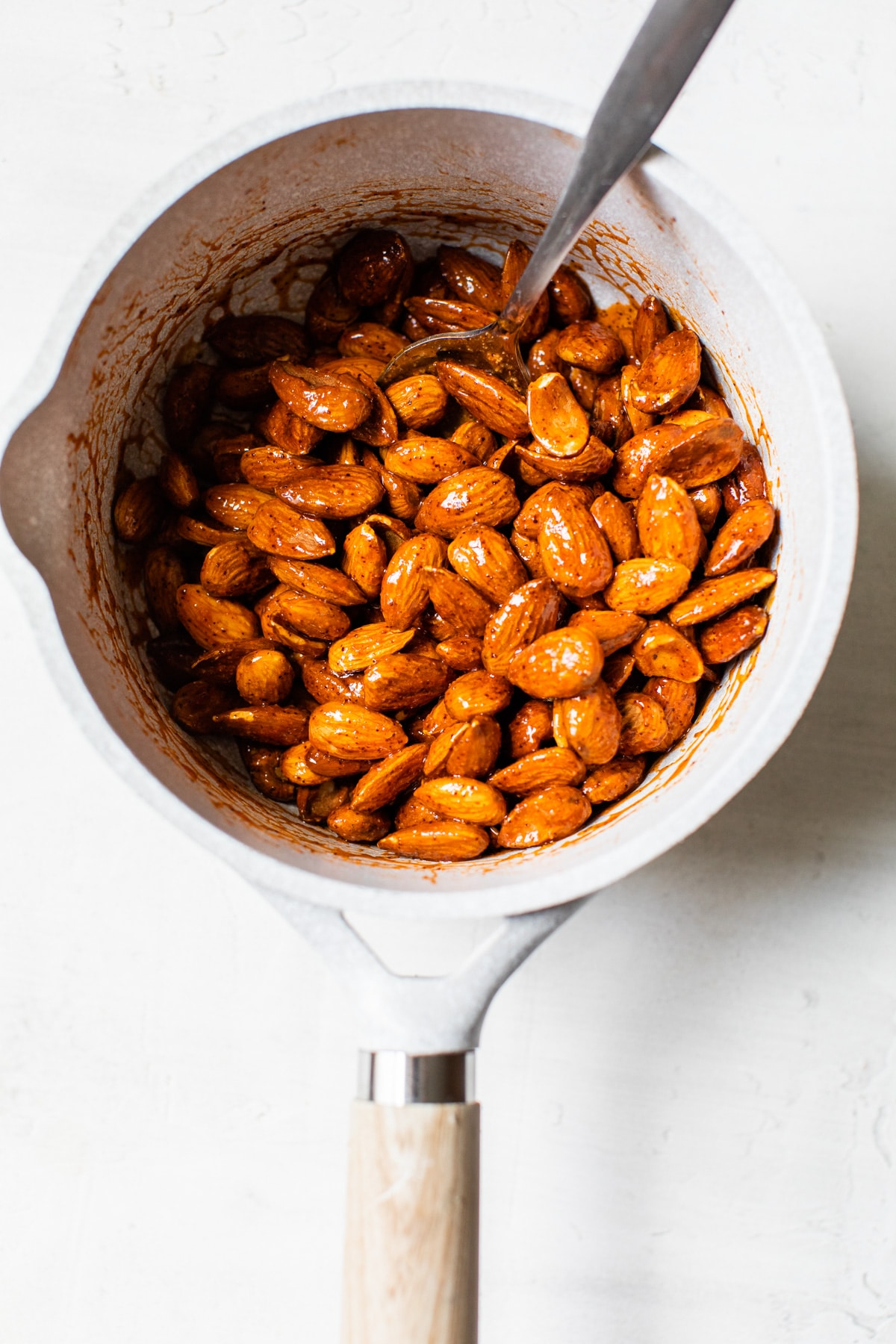 almonds covered in buffalo sauce