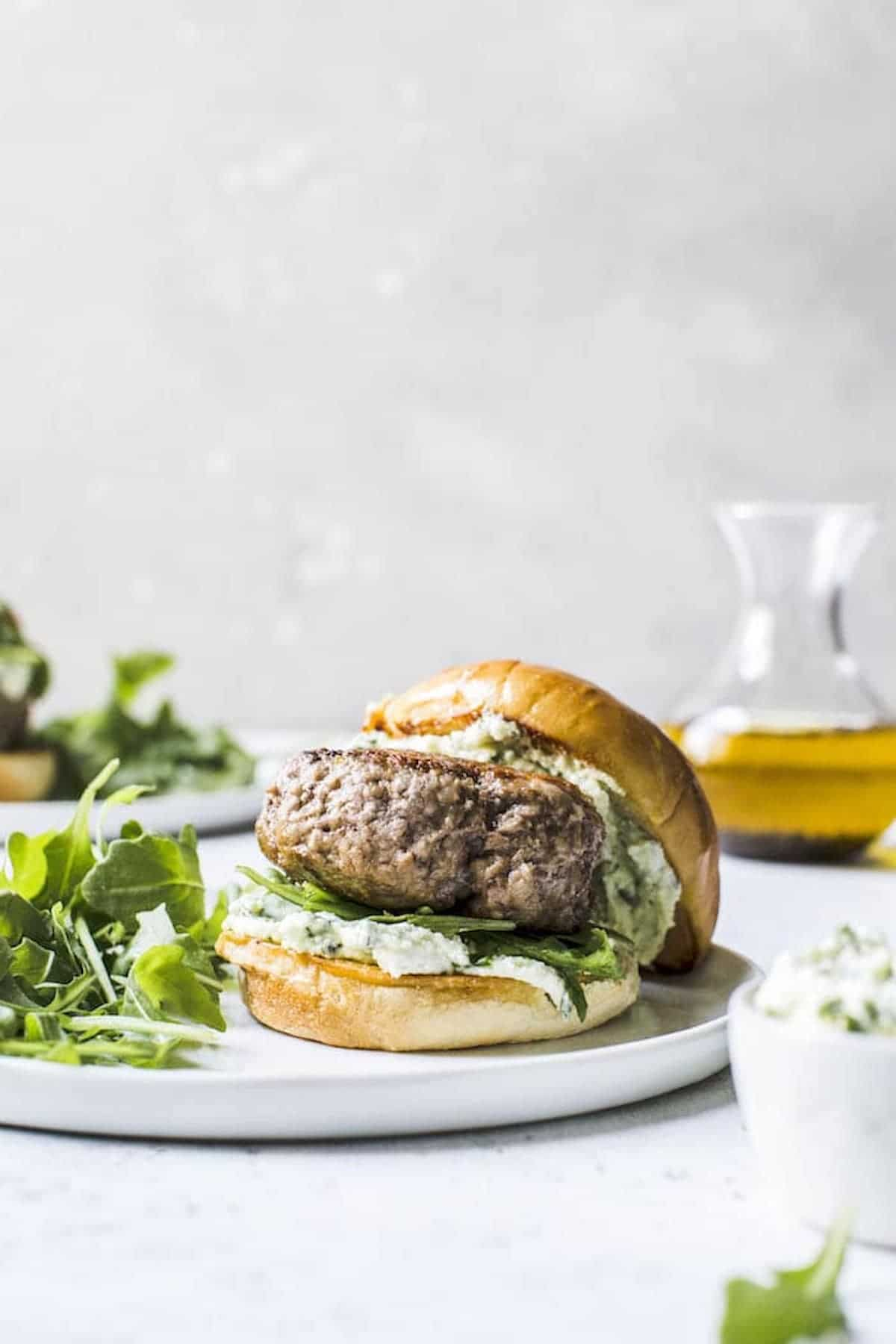 burger topped with feta cheese