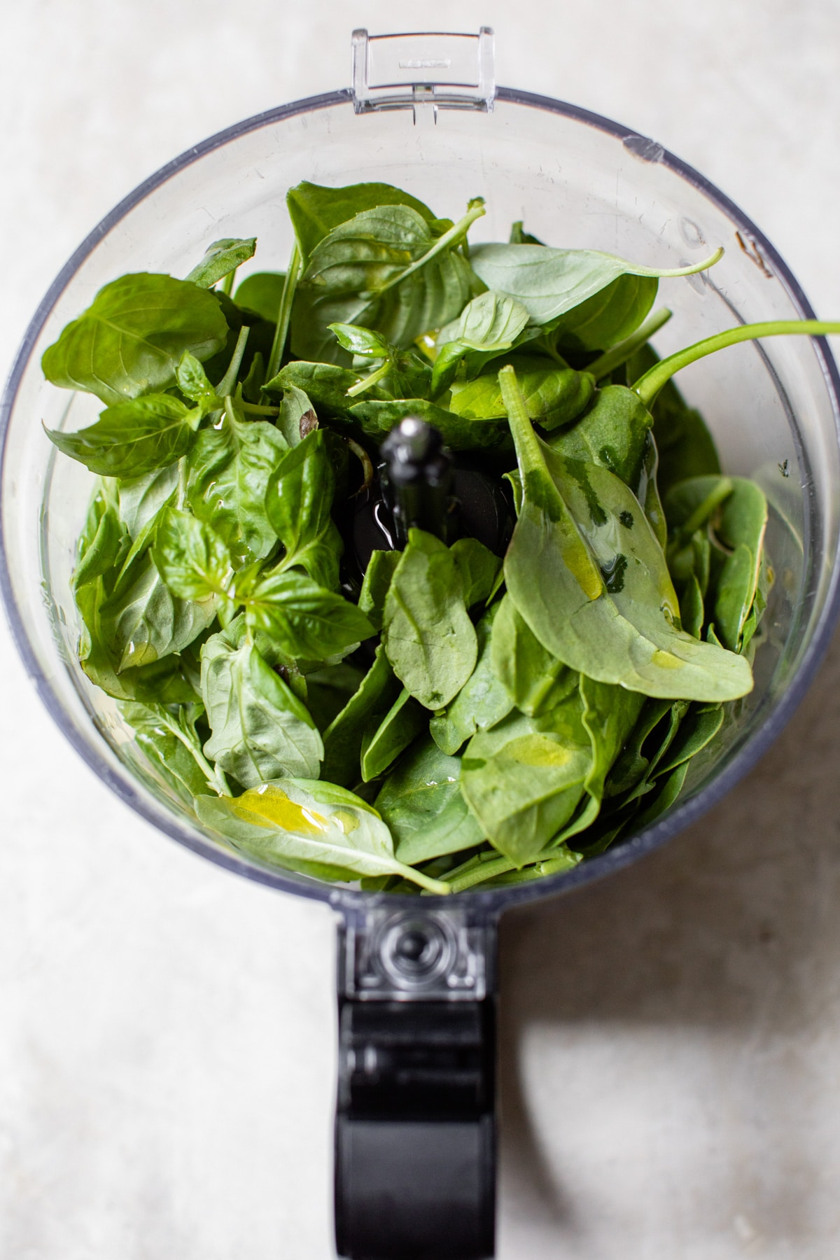 spinach and basil in a food processor