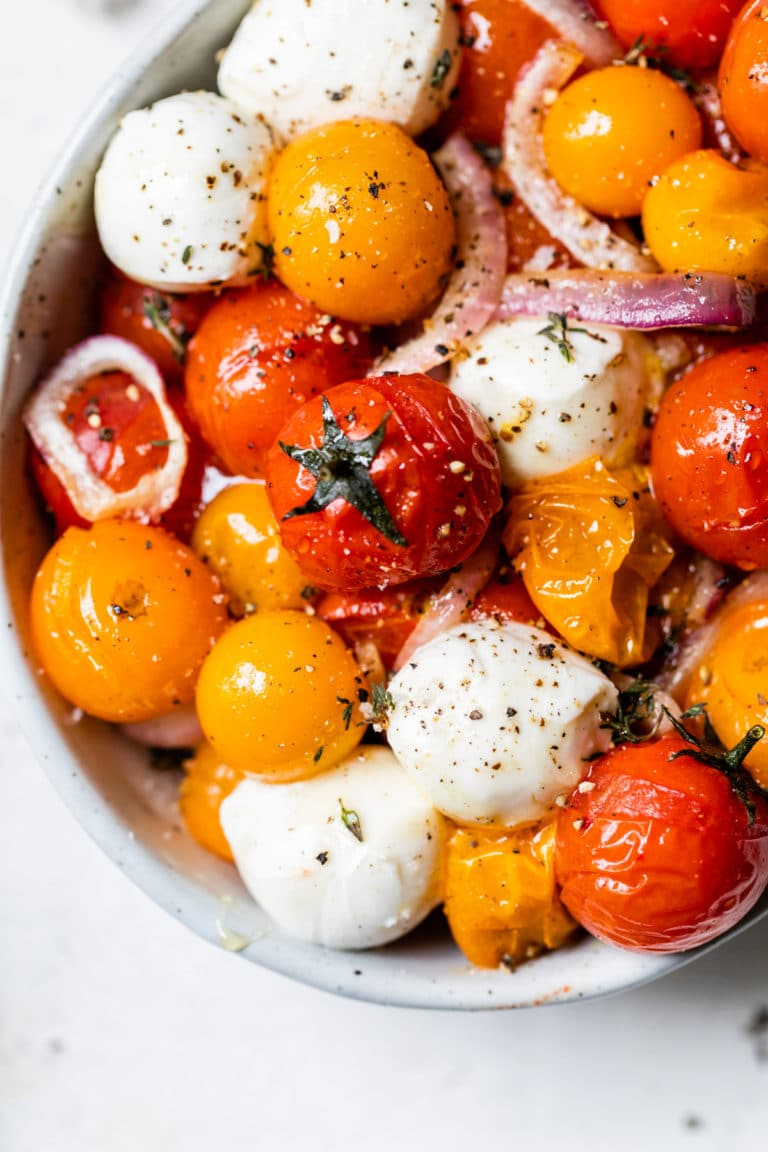 bowl with tomatoes and fresh mozzarella cheese
