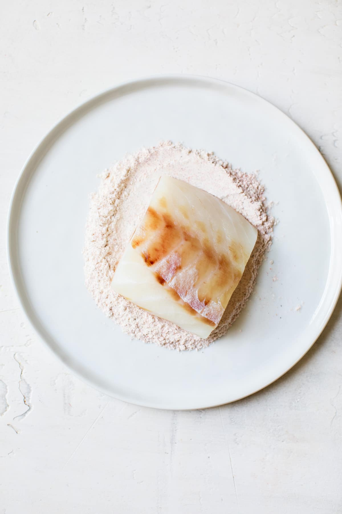 piece of cod on a plate