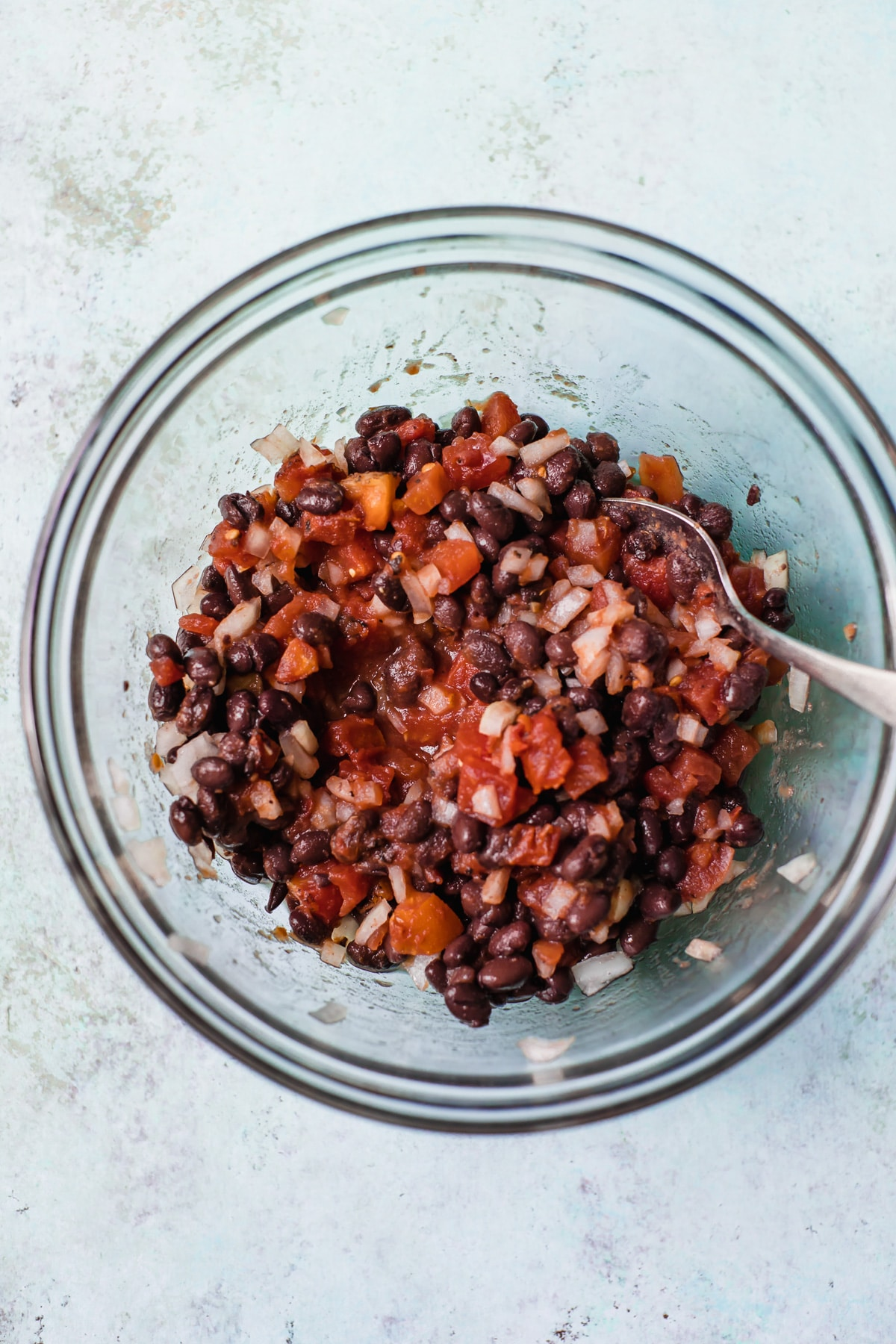 bowl of tomatoes, black beans and onion