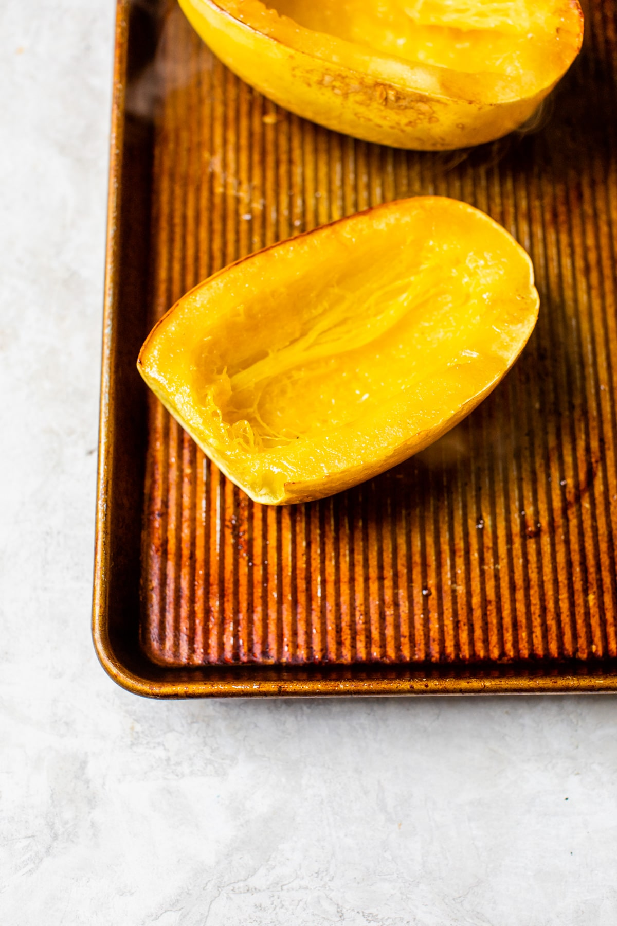 cut squash on a baking sheet