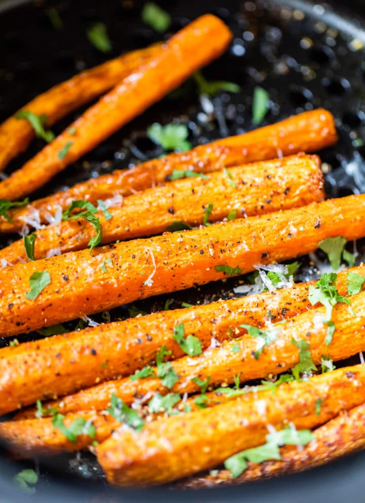 carrots topped with parmesan cheese and parsley
