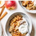a bowl with apples, oats and vanilla ice cream