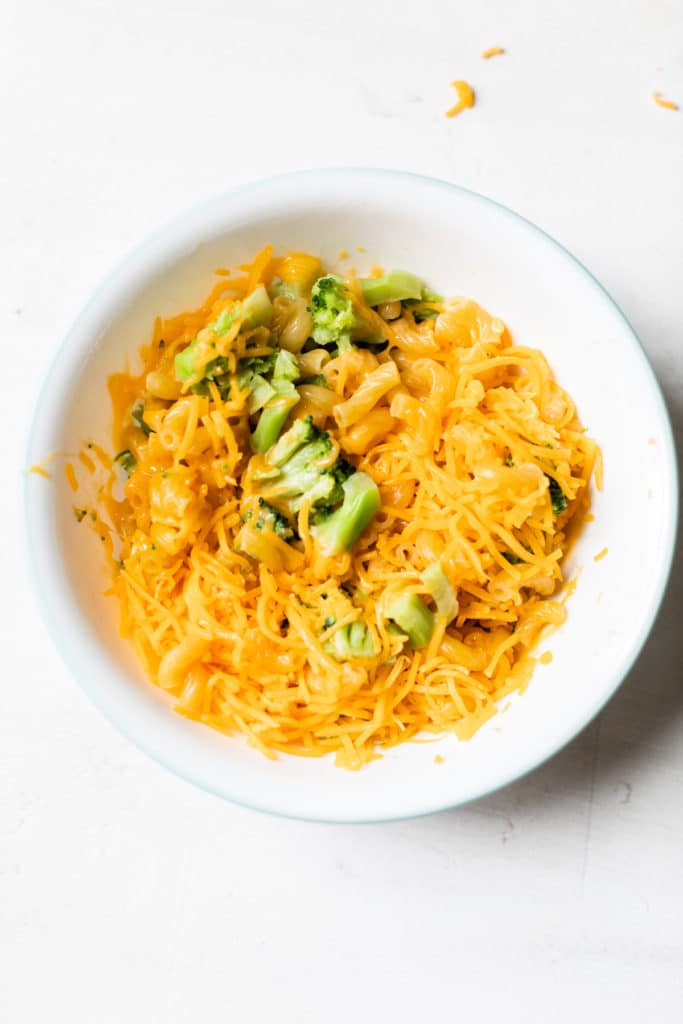 bowl with pasta, broccoli and cheddar cheese