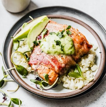 salmon on a plate with cauliflower rice