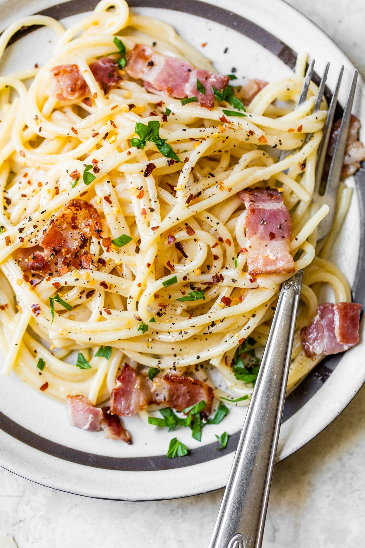 pasta on a plate with bacon and cheese
