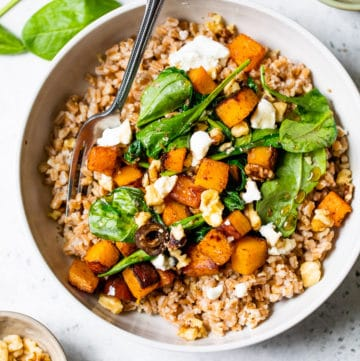 a bowl of farro topped with vegetables