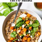 a bowl of farro topped with squash and spinach