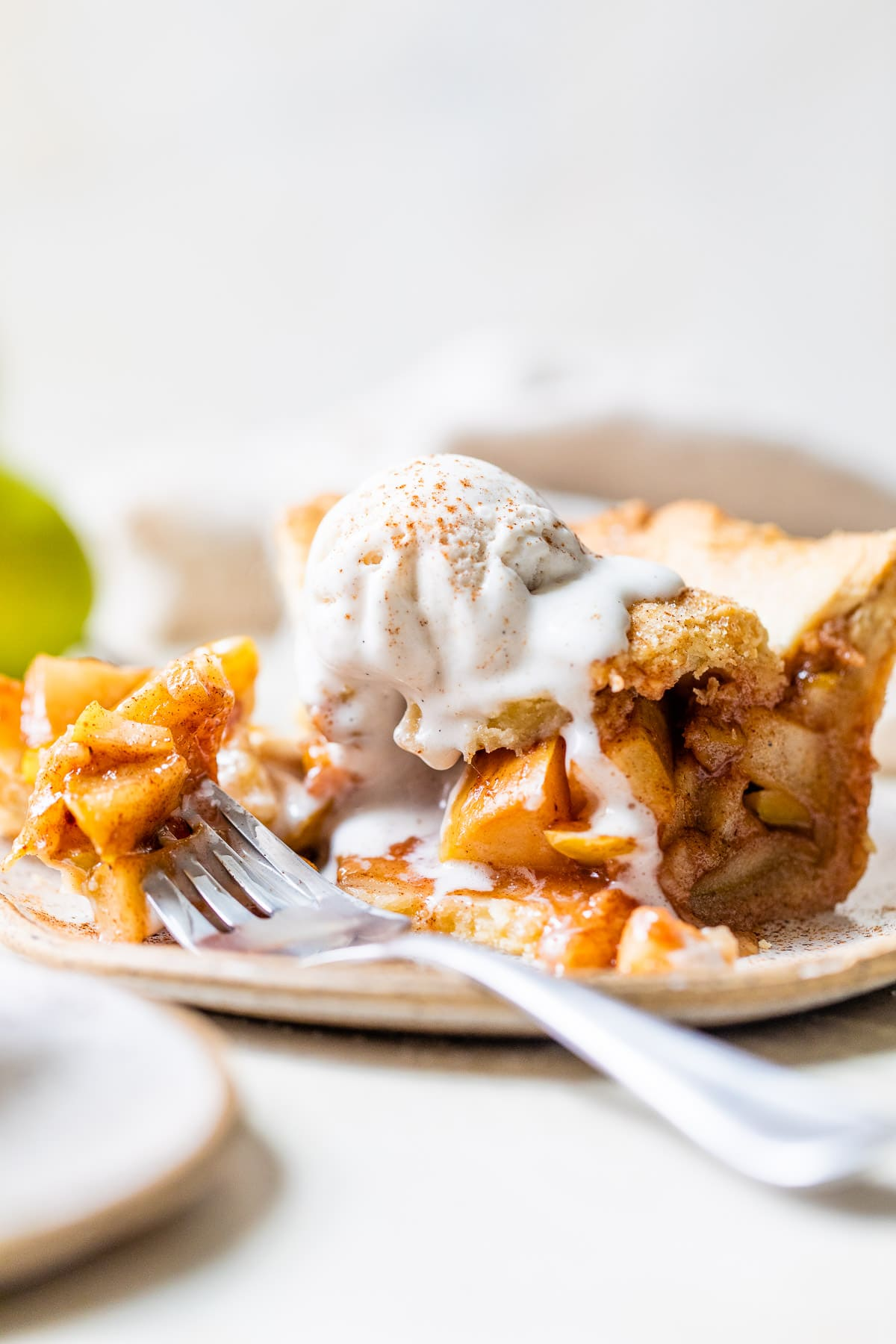 a slice of pear pie topped with ice cream