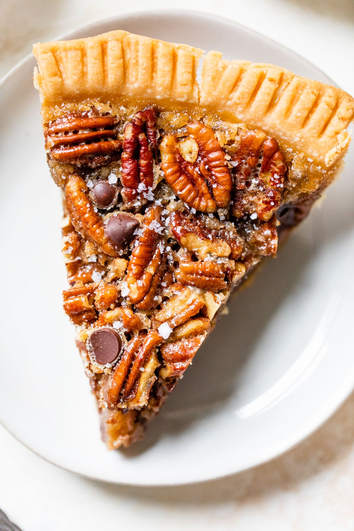a close up of a slice of pecan pie