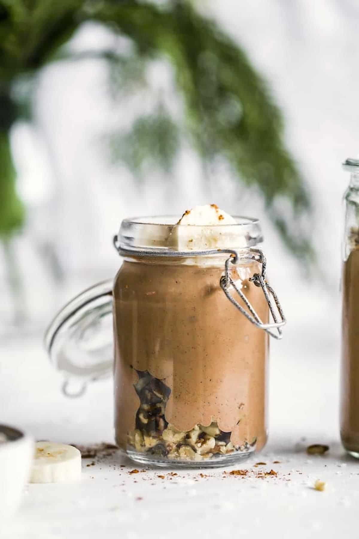 chocolate smoothie with banana in a mason jar