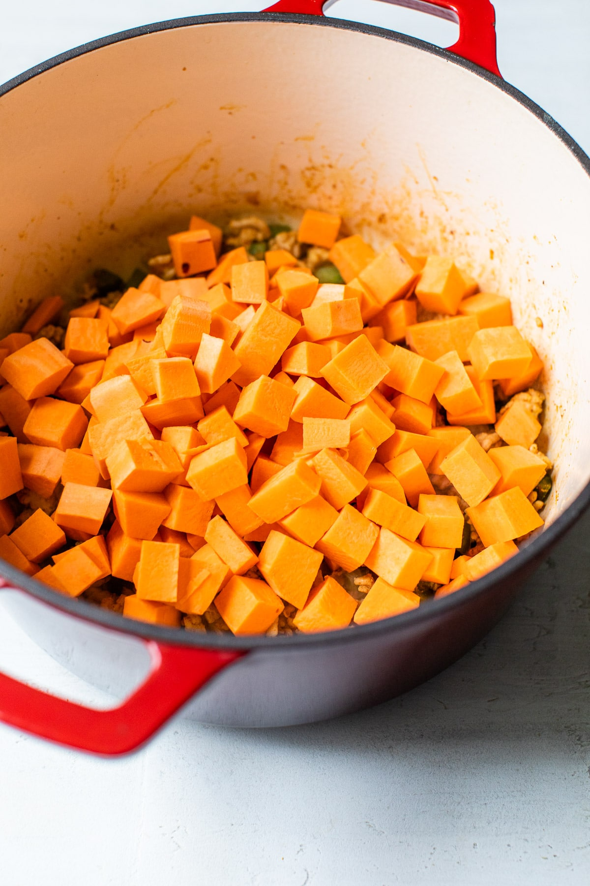 dutch oven with diced sweet potatoes