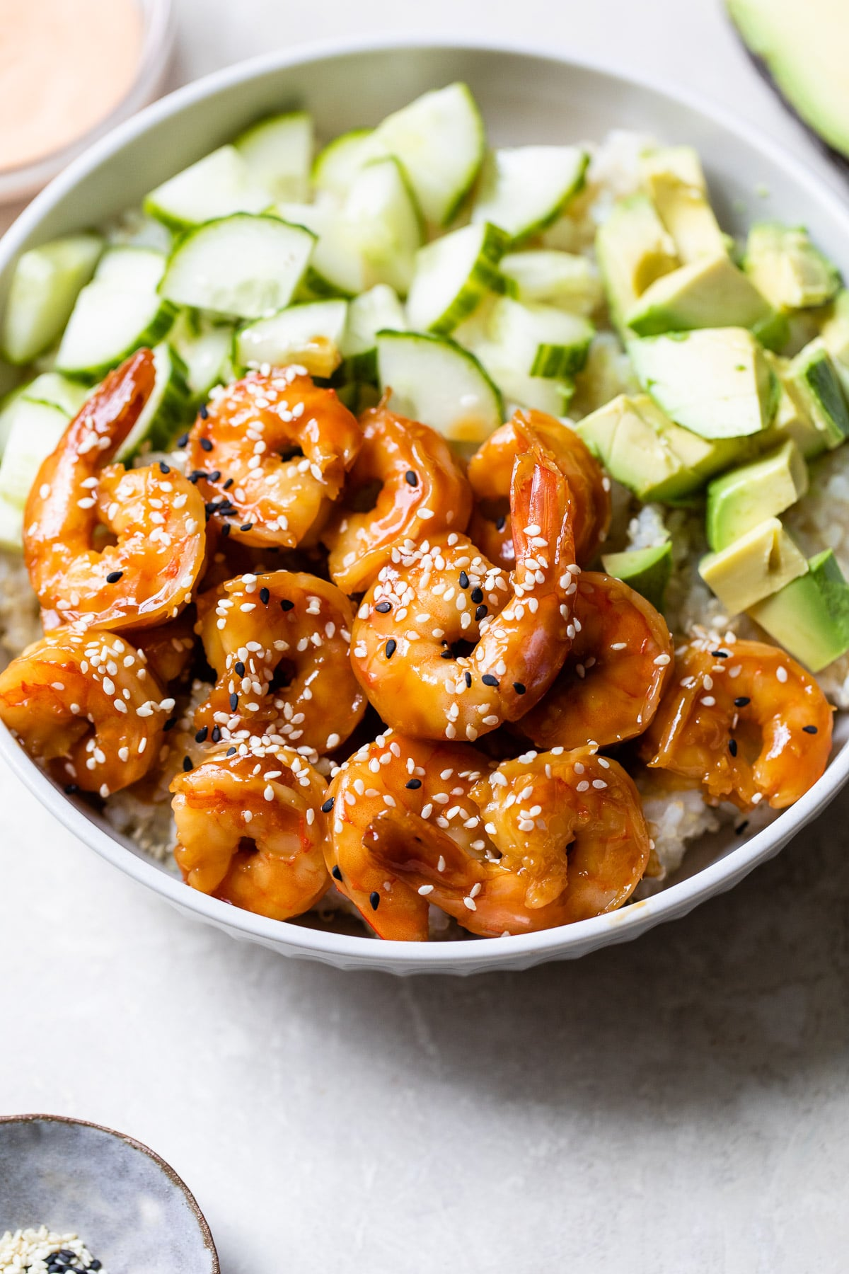 shrimp in a bowl topped with sesame seeds