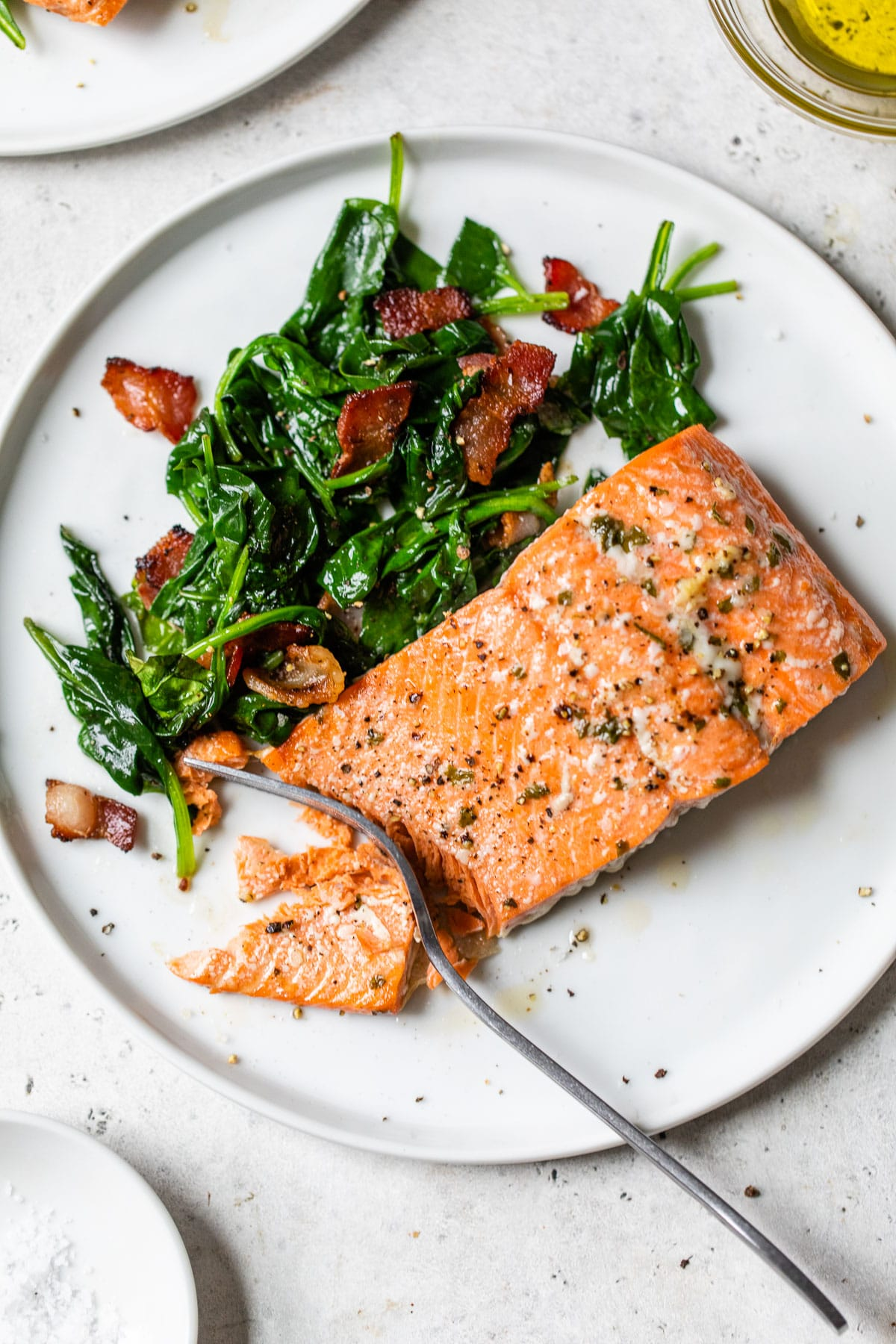 cooked salmon and spinach on a plate