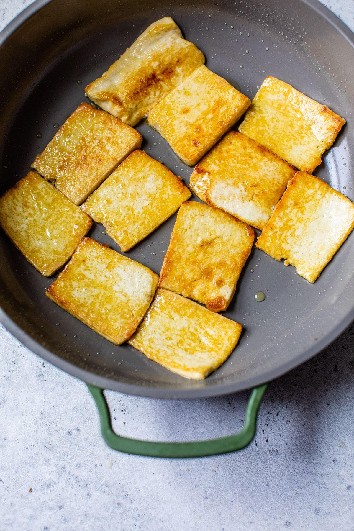 pan-fried tofu in a skillet