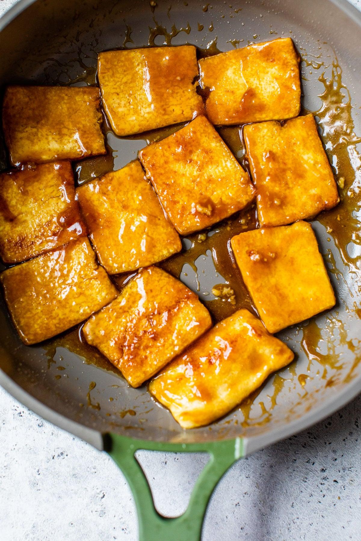marinated tofu in a skillet
