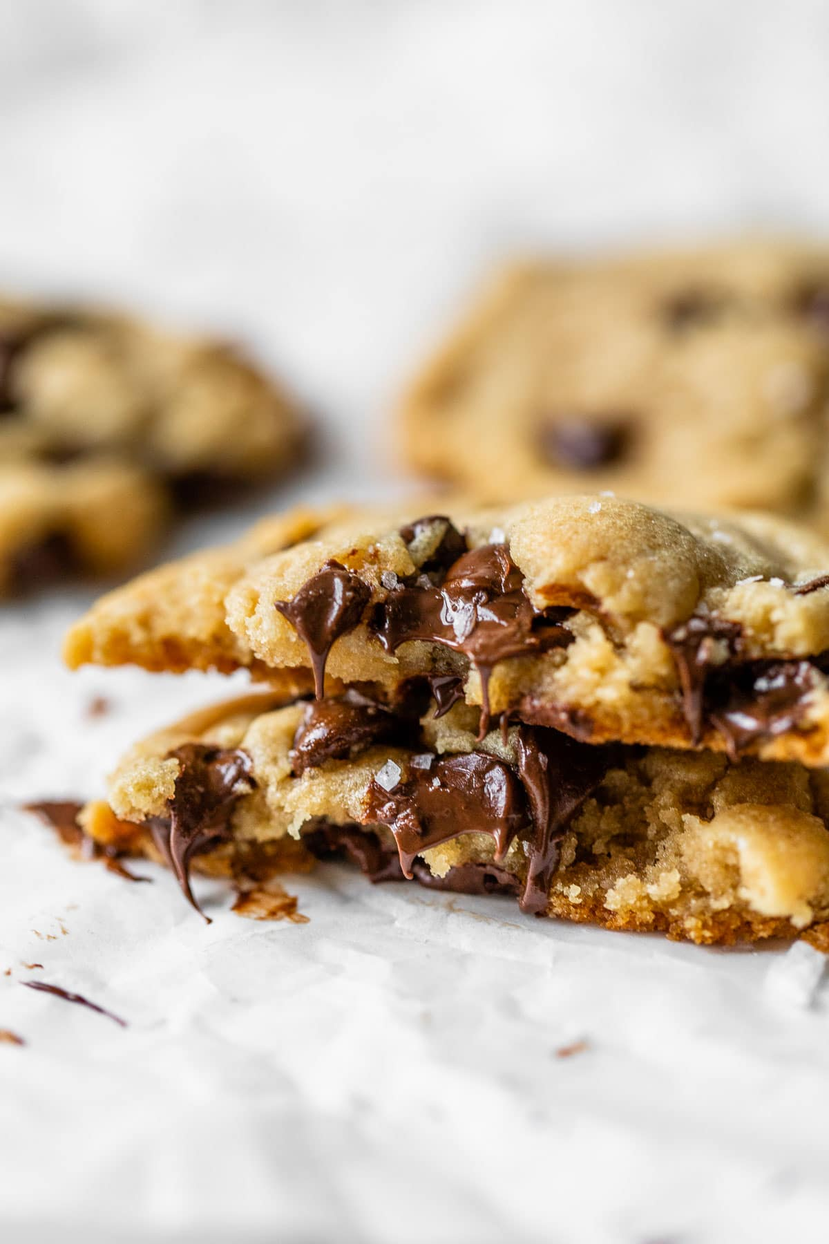 a brown chocolate chip cookie with melted chocolate chips