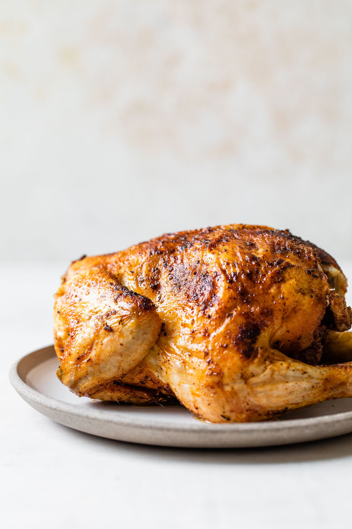 whole cooked chicken on a plate
