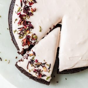 round chocolate cake topped with pink icing