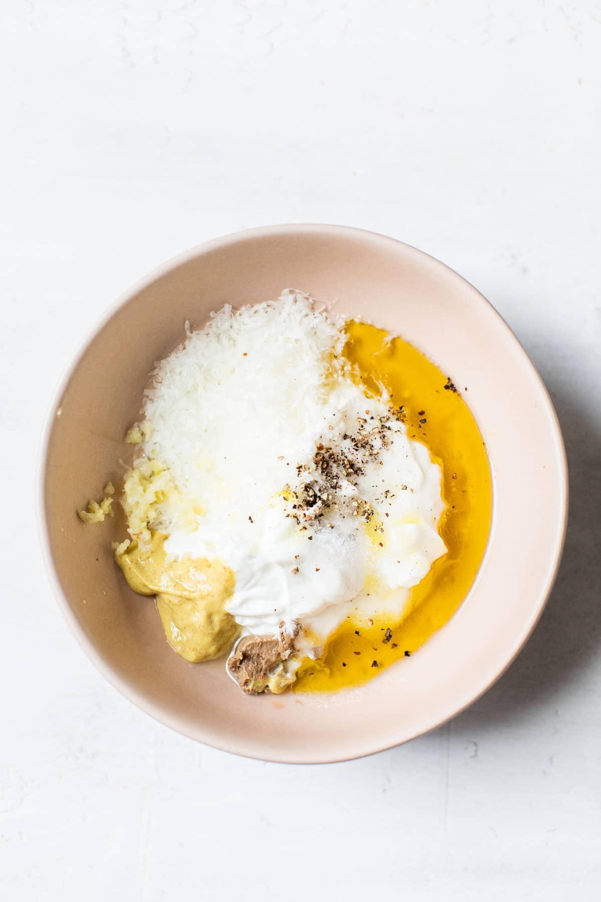 caesar salad ingredients in a bowl