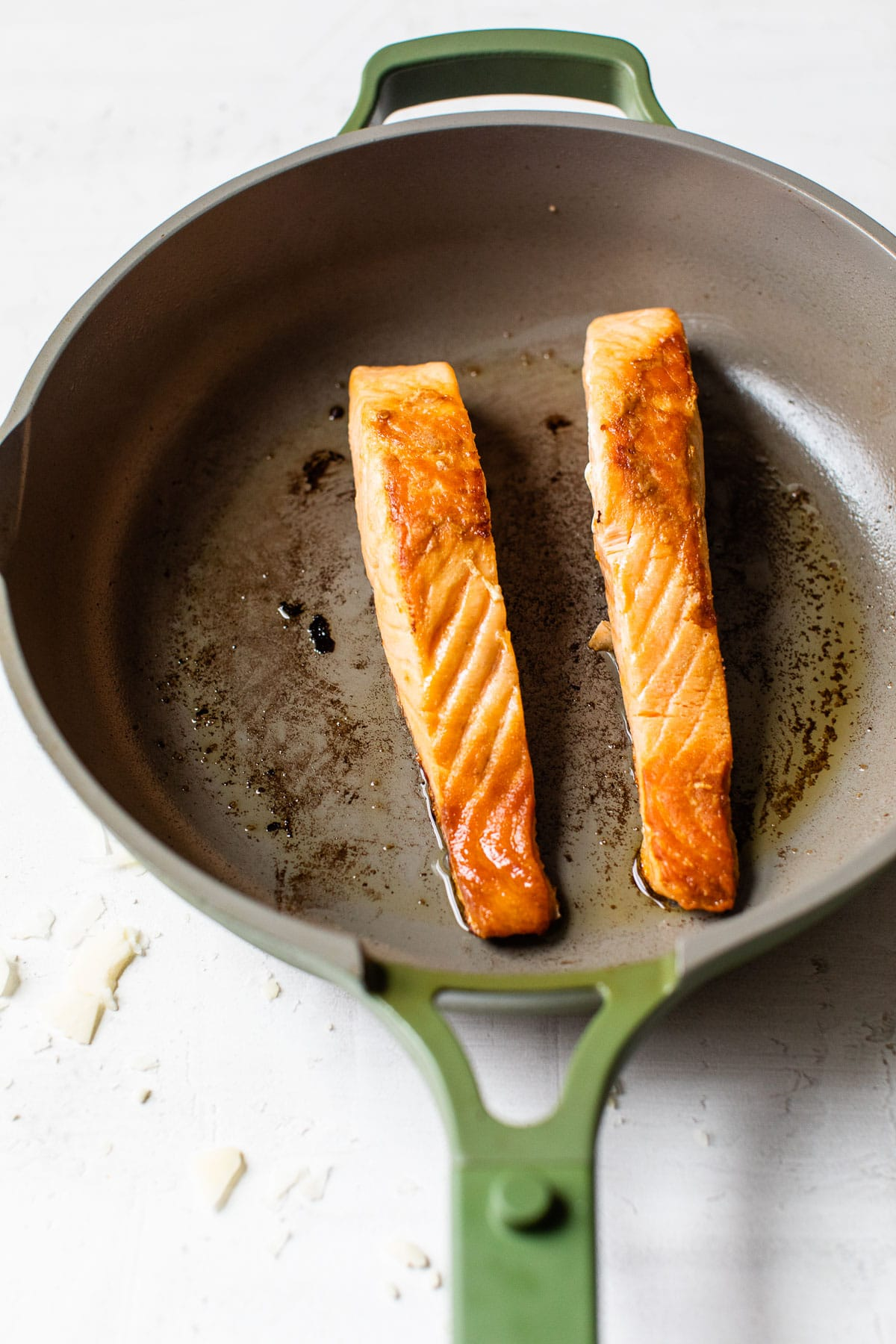cooked salmon in a skillet