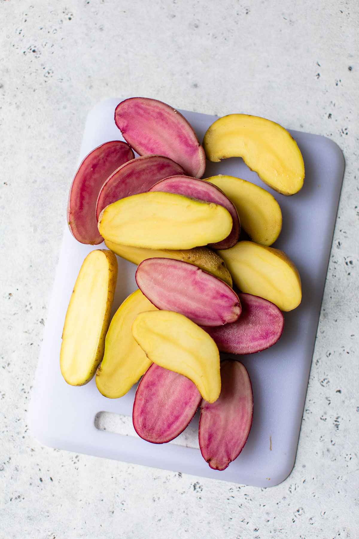 sliced potatoes on a cutting board