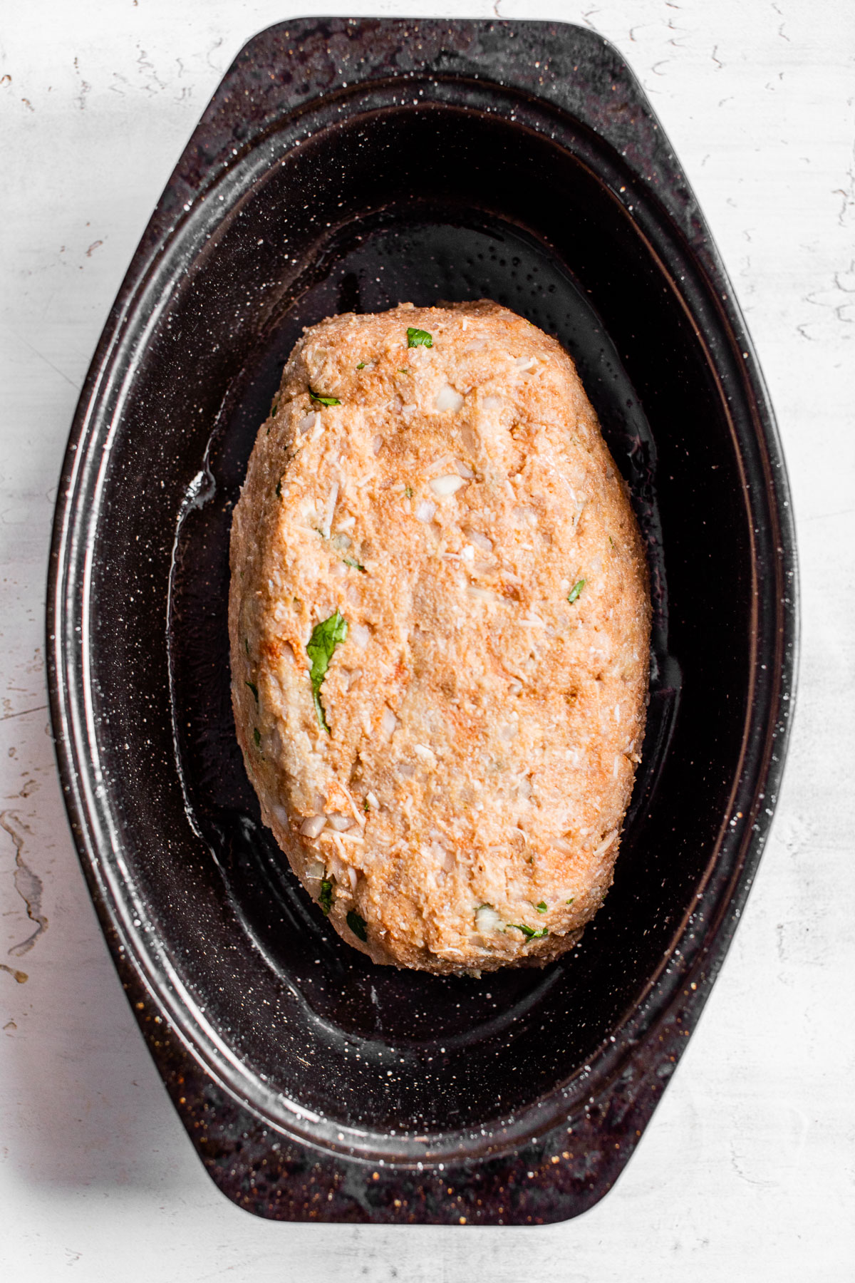 uncooked meatloaf in a baking dish