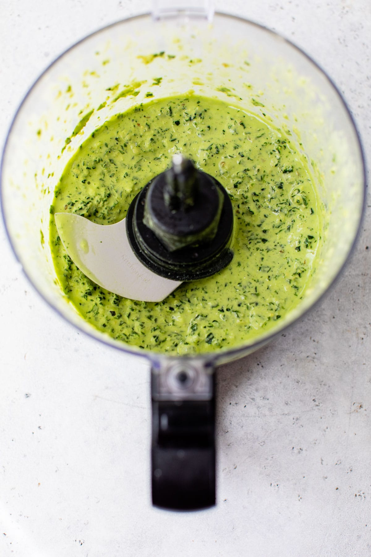 blended pesto sauce in a food processor