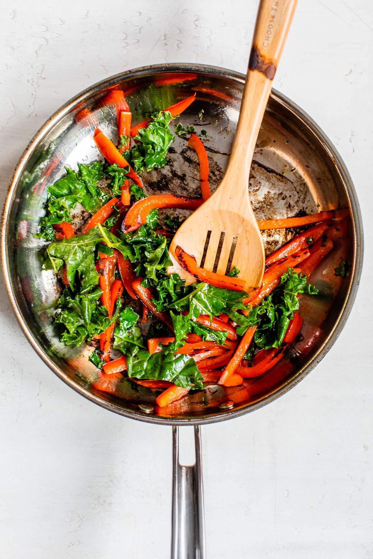 cooked bell pepper and kale in a skillet