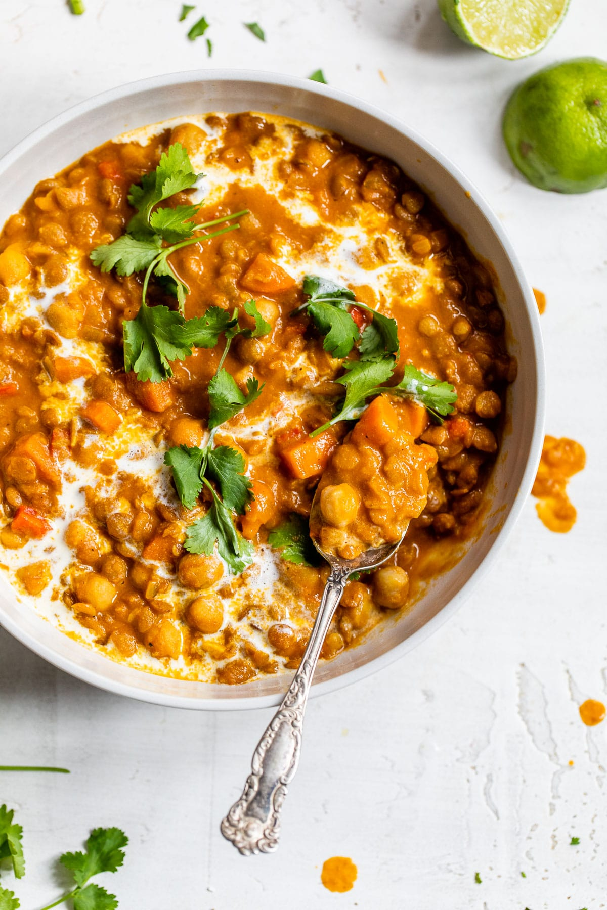 chickpeas and lentils in a bowl topped with cilantro