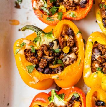 stuffed bell peppers in a casserole dish