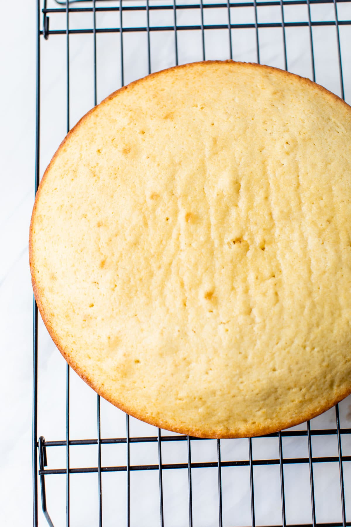 a round cake on a cooling rack