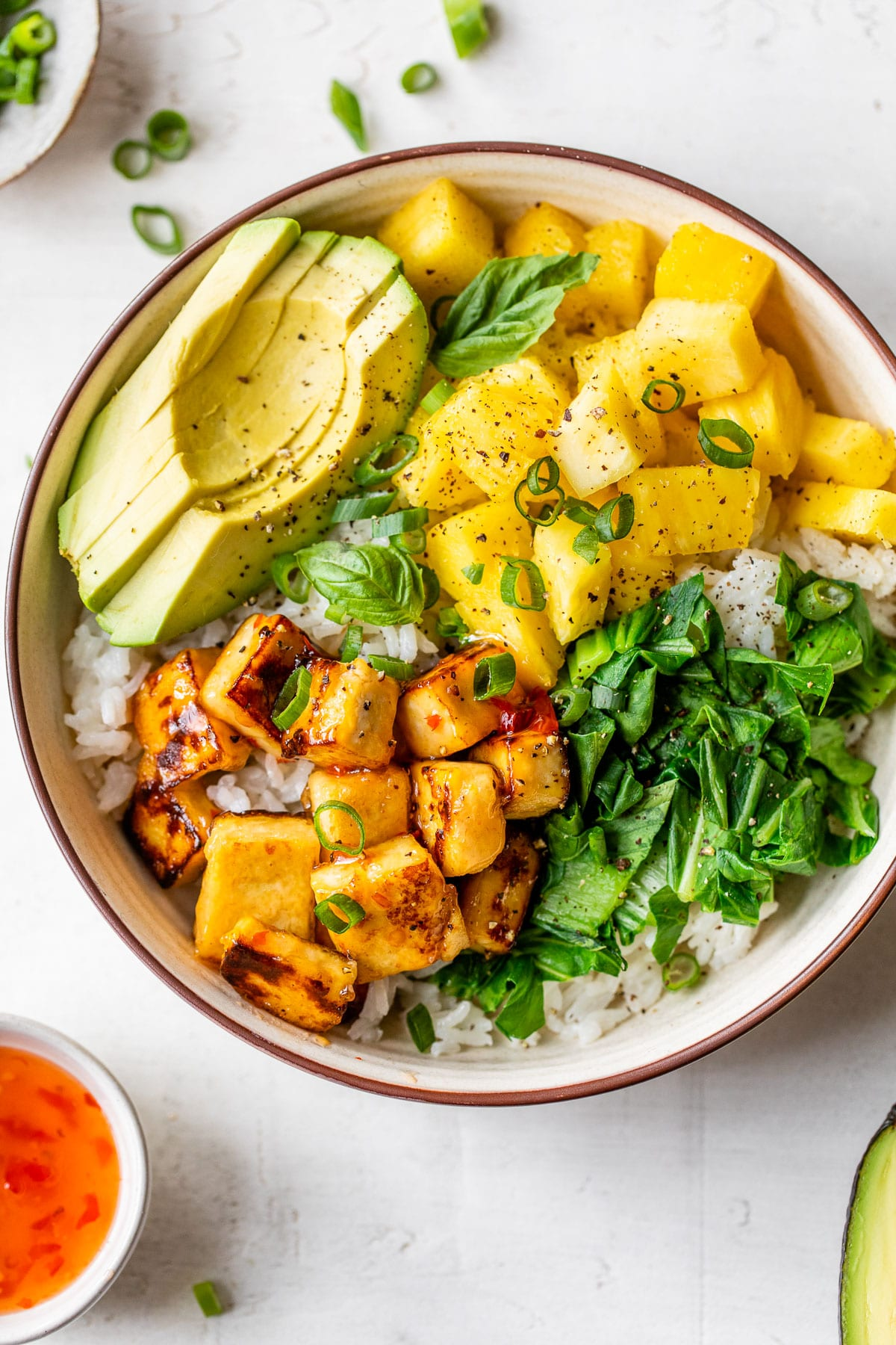 rice bowl with diced pineapple, avocado and diced tofu