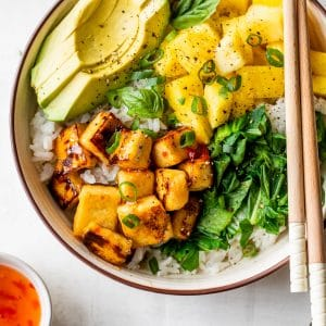 bowl with white rice, tofu, pineapple, and avocado