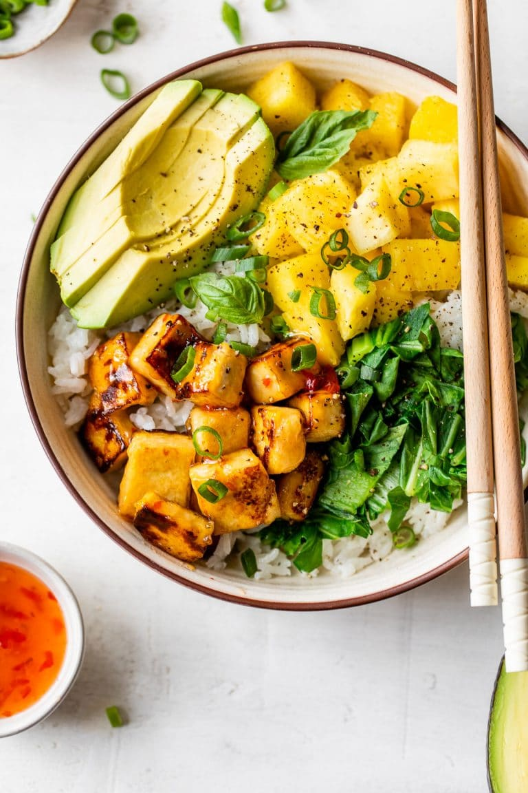 bowl with white rice, tofu, pineapple, and avocado