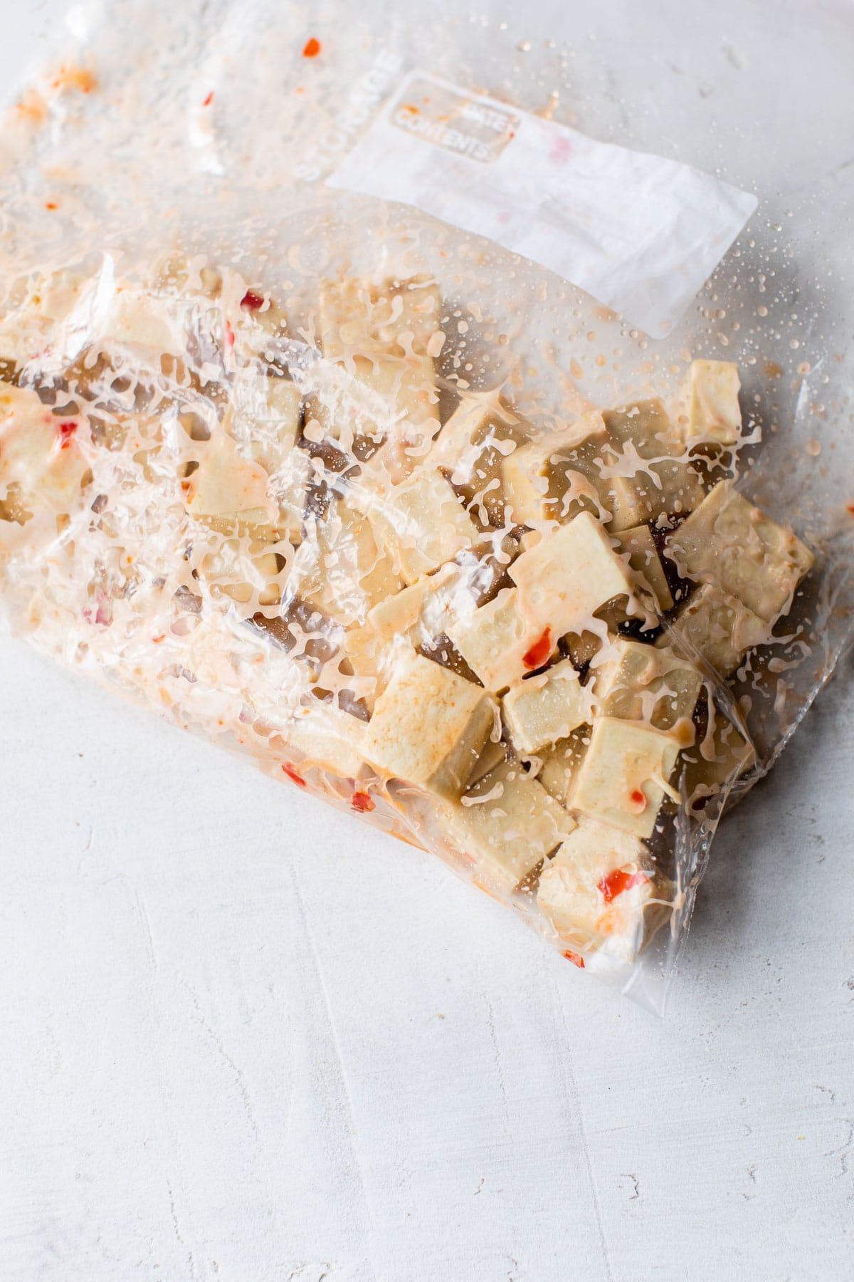 tofu marinating in a plastic bag