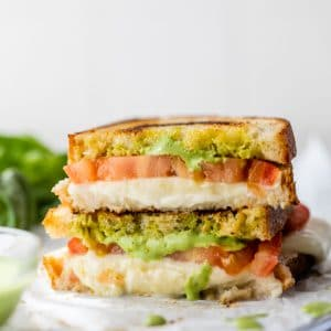 stacked grilled cheese with tomato and mayo